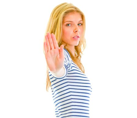 certitude: Serious teen girl showing stop gesture isolated on white   Stock Photo
