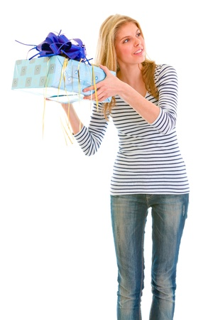 interrogatively: Interested teengirl shaking present box trying to guess whats inside  Stock Photo