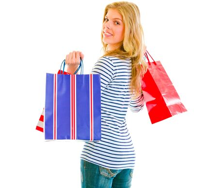 Smiling teen girl with shopping bags isolated on white 