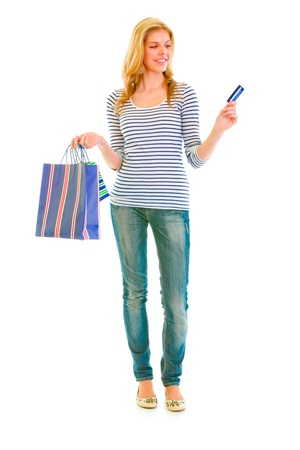 Full length portrait of attractive teengirl with shopping bags and credit card