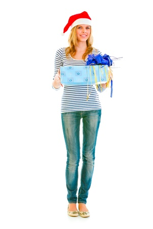 Full length portrait of lovely teengirl in Santa hat presenting gift Stock Photo - 10843966