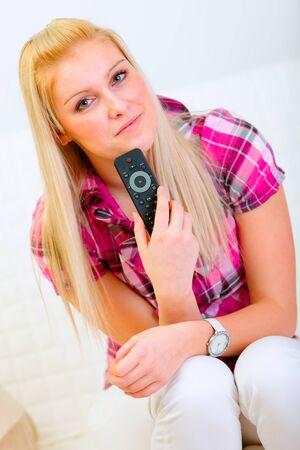 tv remote: Portrait of happy pretty woman with TV remote control