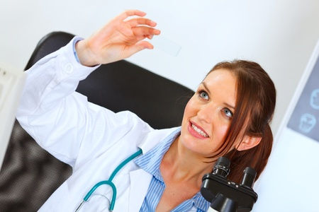 Happy female medical doctor working with sample Stock Photo - 10932143
