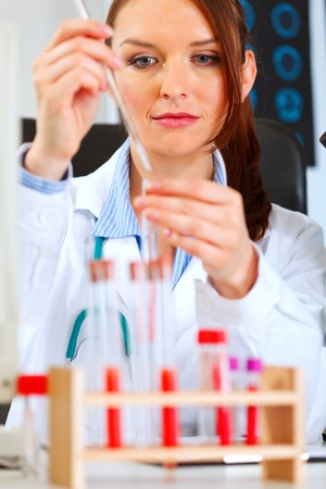 conducting: Medical doctor woman conducting tests in laboratory