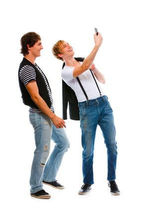 Two modern teenage boys making photos on cell phone. Isolated on white Stock Photo - 10932159