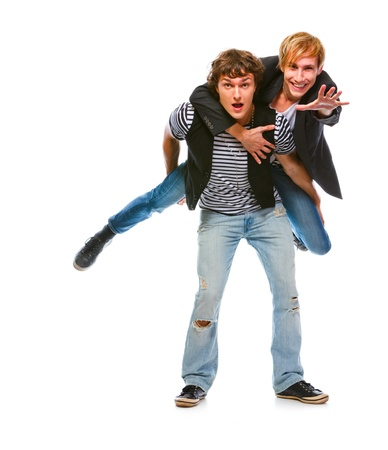 backing: Cheerful modern man piggy backing his friend. Isolated on white