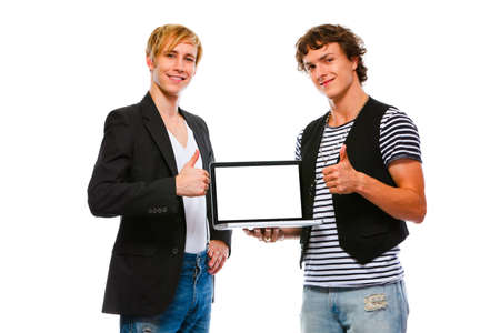 Two happy  men showing laptops blank screen. Isolated on white  photo