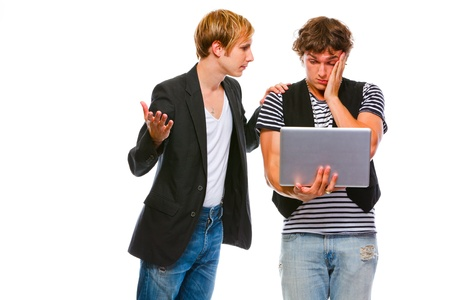 reassure: Young modern man calms his looking in laptop friends. Isolated on white  Stock Photo