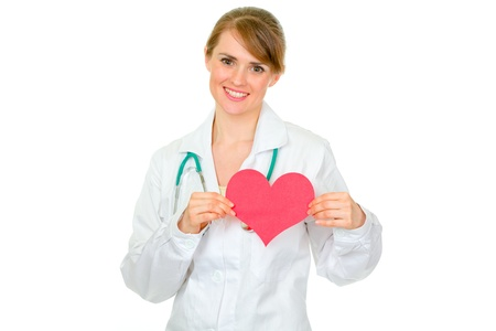 Smiling medical doctor woman holding paper heart isolated on white