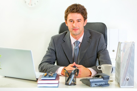 Portrait of happy  businessman in office  photo