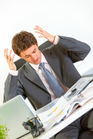 Confused businessman lost in documents  photo