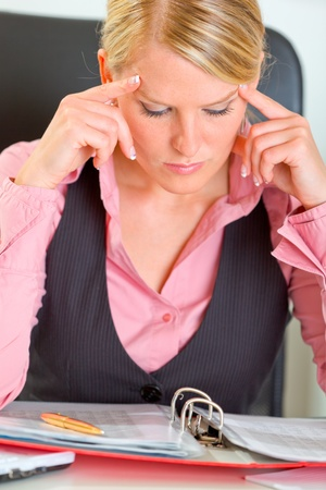 Portrait of hard working on document business woman Stock Photo - 11076326