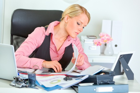 hard working woman: Hard working on documents business woman