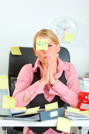 uptight: Begging for help female manager sitting at workplace covered with sticky notes