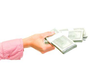 Female hand holding packs of dollars isolated on white Stock Photo - 11076282