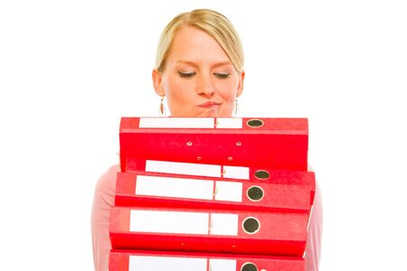 aghast: Confused woman with pile of folders isolated on white  Stock Photo
