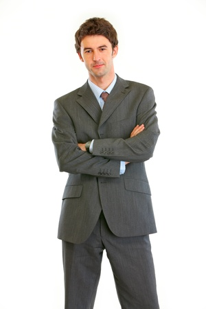 authoritative: Authoritative modern businessman with crossed arms  isolated on white