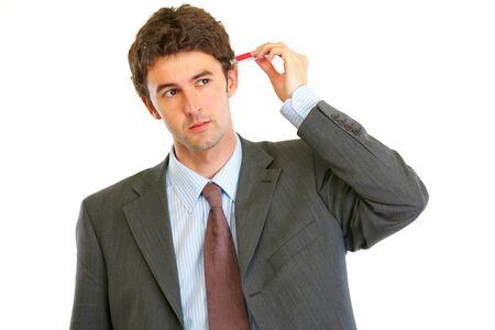 usb flash: Modern businessman trying to plug usb flash in head  isolated on white  Stock Photo