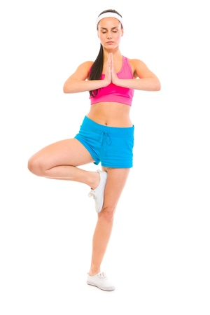 centrality: Full length portrait of fitness girl in yoga pose isolated on white  Stock Photo