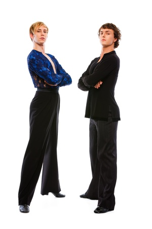 Two ballroom male dancers with crossed arms on white background   photo