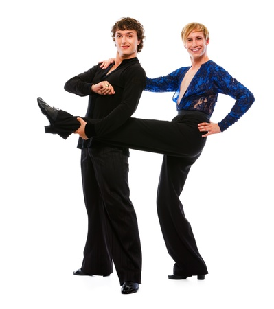 merry dancers: Latino male dancer holding leg of his funny posing friend