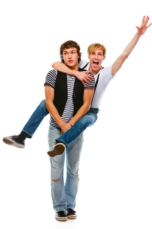 white backing: Cheerful teenager piggy backing his friend. Isolated on white