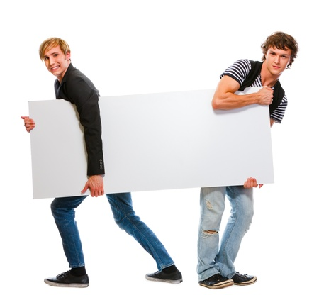 gay lifestyle: Two teenagers pulling blank billboard. Isolated on white