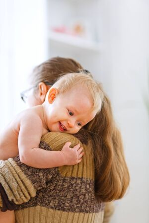 Little cute baby hanging mama at home Stock Photo - 11151246