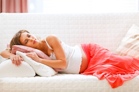 Lovely pregnant woman sleeping on sofa  photo