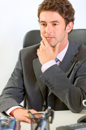 sagacious: Portrait of thoughtful modern businessman in office  Stock Photo
