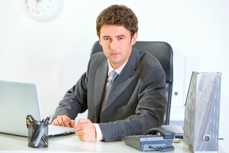 banging: Angry modern businessman banging fist on table  Stock Photo