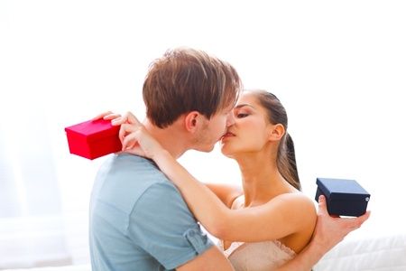 young couple kissing: Young couple kissing after exchanging presents