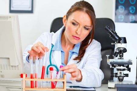 Female medical doctor working with test tube in laboratory Stock Photo - 11383344