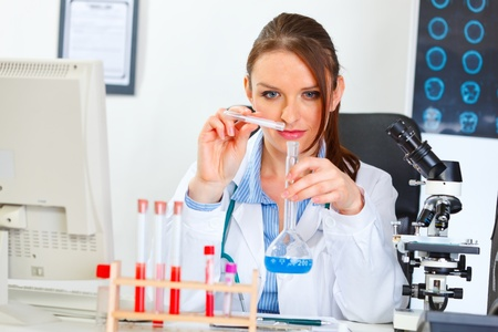 centrality: Doctor woman working with test tube in laboratory