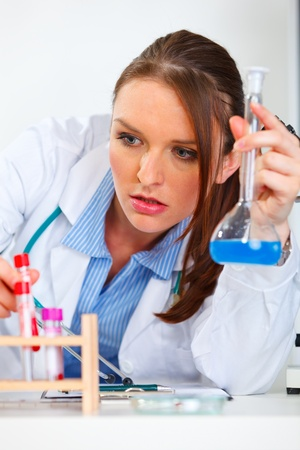 centrality: Closeup on doctor woman working with test tube in laboratory  Stock Photo