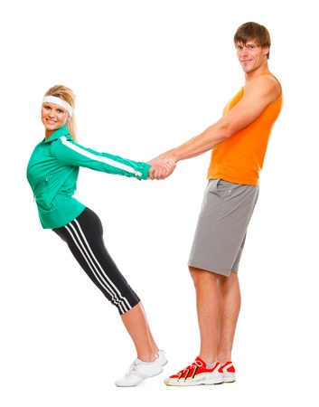 male athlete: Slim young woman and male athlete having fun isolated on white