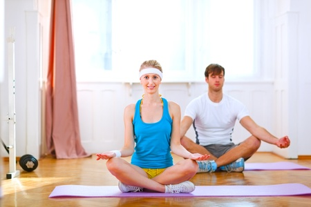 Healthy couple doing yoga at home  photo