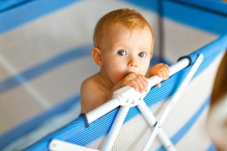 interrogatively: Portrait of baby in playpen