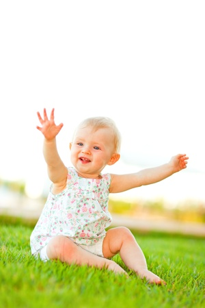 interrogatively: Lovely baby playing on grass