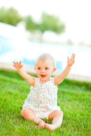 baby playing: Happy baby playing on grass