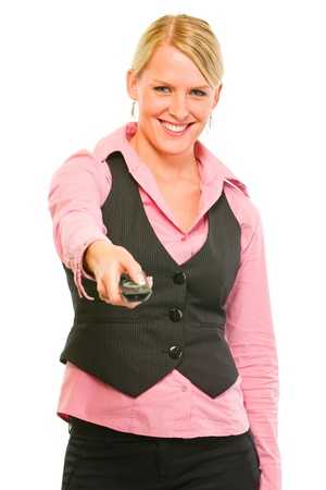 tv remote: Happy modern business woman with TV remote control in hand