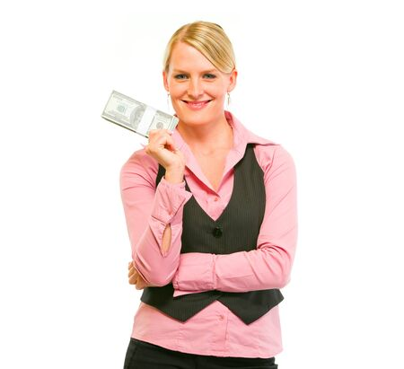 Smiling modern female business secretary holding dollars pack Stock Photo - 11640547