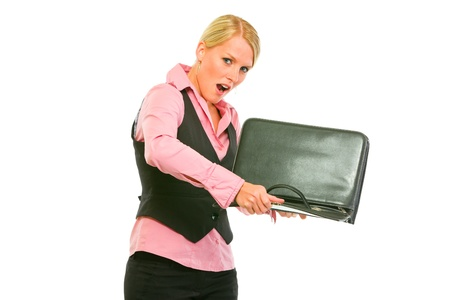 shaking out: Unhappy modern business woman shaking out something from briefcase