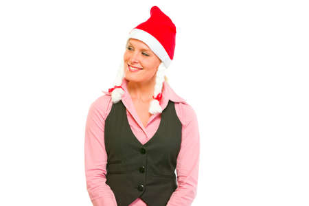 Happy female business secretary in Santa Hat looking in corner on copy space  photo