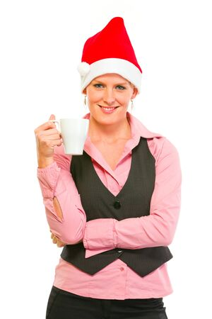 Happy modern business woman in Santa Hat with cup of coffee  photo