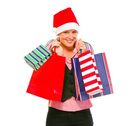 Happy female business secretary in Santa Hat with shopping bags  photo