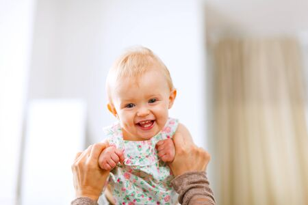 laughing baby: Portrait of lovely laughing baby playing with mother