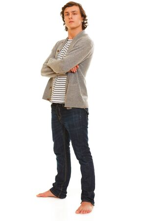 certitude: Full length portrait of young man isolated on white