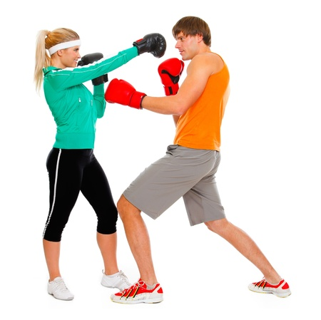 Male and female par in sportswear boxing isolated on white  photo
