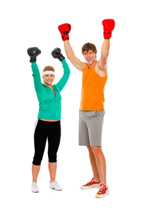 par: Male and female par in boxing gloves celebrating victory isolated on white